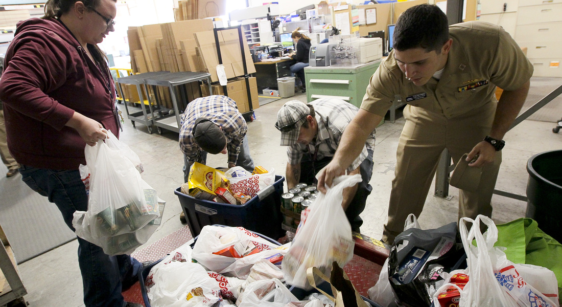 Us navy 111123 n hw977 185 sailors weigh thanksgiving food drive donations before delivery to the corona norco settlement house